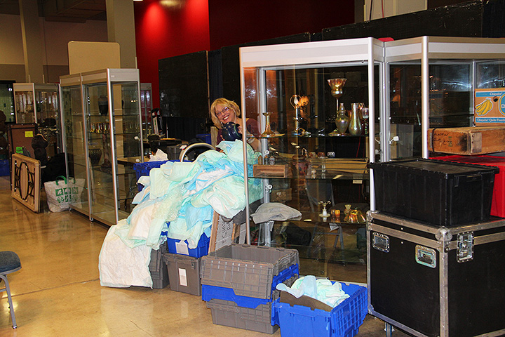My lovely wife, Lia, is busy setting up our booth