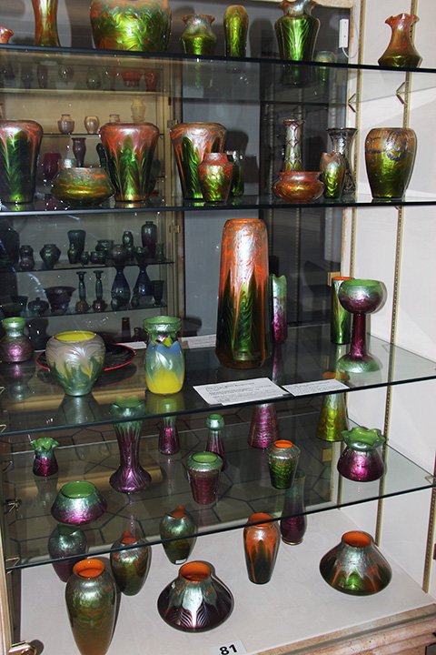 All of the vases in this cabinet are examples of Titania glass