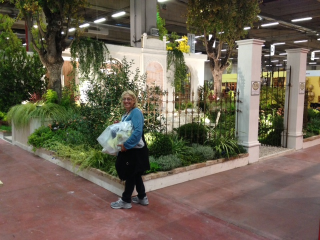 Lia is in front of a fabulous garden display at the show