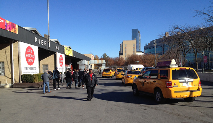 A line of taxis was dropping off early arrivals on Saturday morning
