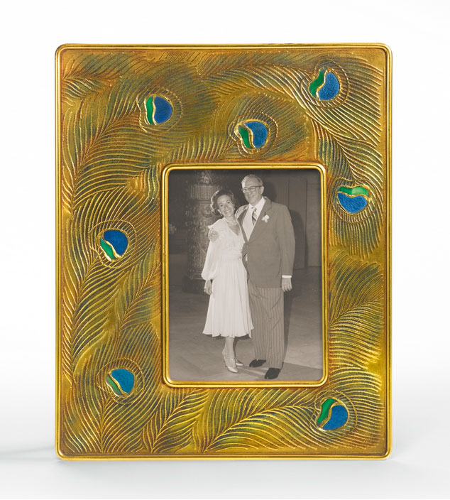 This rare Tiffany Studios Peacock frame, Sotheby's lot #2, sold for $40,000, against a pre-sale estimate of $5,000 - $7,000