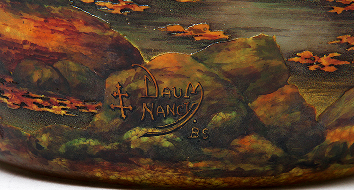 This hand-painted Daum signature is a work of art