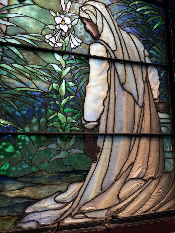 One of the many original Tiffany Studios windows in St. Michael's, with fantastic drapery and mottled glass