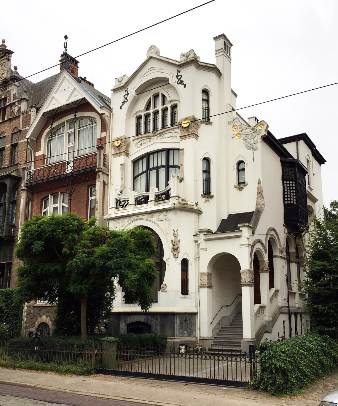 The beige Art Nouveau home is assymetrical