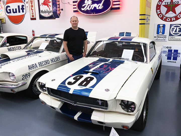 That's John by his pride and joy -- the first Shelby Mustang competition car ever built